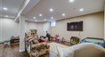 Finished basement with high ceilings. Outside entr