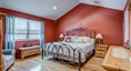 Master bedroom with cathedral ceiling. Ensuite bat