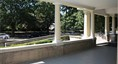 Gracious Porch and reception space at exterior of